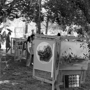 Students viewing art exhibit outside