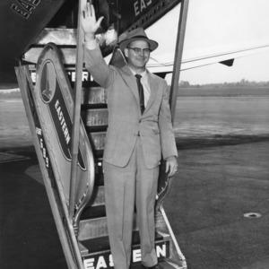 John B. Gaither departing on a plane