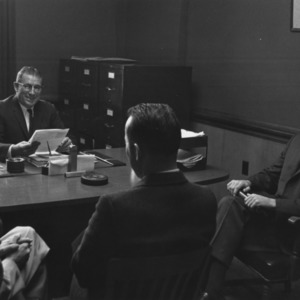 George H. Dunlap and others in meeting