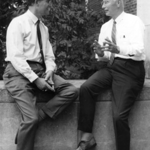 Dean David Chaney (right) and Peter Lord having a discussion