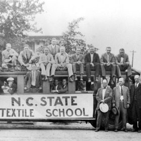 North Carolina State Textile School students and faculty. Professor Hilton standing fourth from right, Dean Thomas Nelson standing second from right.