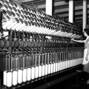Woman with a yarn machine
