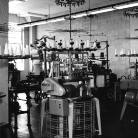 Brinton knitting machine in textile lab, probably in Tompkins Hall