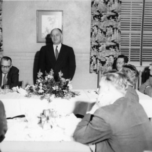 L. R. Harrill leads the group in the summary discussion of the school [4-H tractor program] at the final luncheon in the Grill Room of the State College cafeteria
