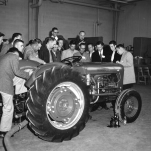 4-H club members examining a tractor at a 4-H club tractor program