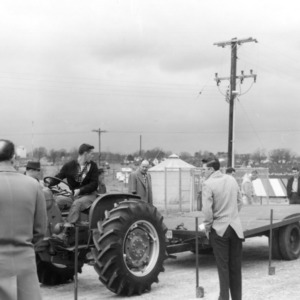 4-H club member driving a tractor at the 4-H tractor program