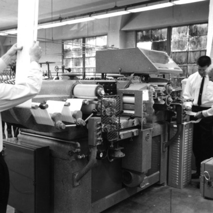 Left to right: L. T. Lassiter , Kenneth Lynch, and Arthur Woodbury with a Turbo Stapler machine