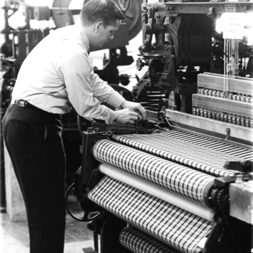 Man working with a loom?