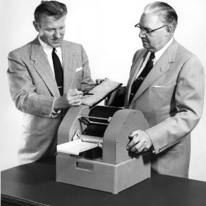 John F. Bogdan and Dean Malcolm E. Campbell with nepometer