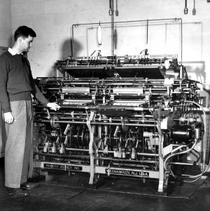Man examining a Robert Rener machine