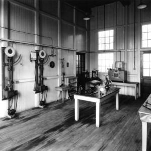 Textiles (Tompkins Hall) with view of scales and weighing equipment