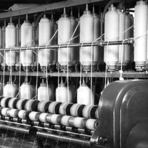 Close-up view of textile equipment -- yarn on bobbins?