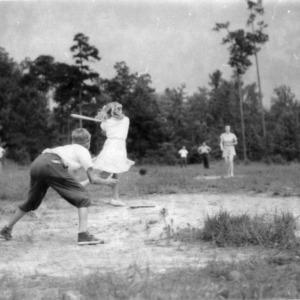 4-H club members playing softball at Camp Millstone