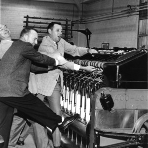 Professor E. B. Grover and two others playing around a Saco-Lowell machine