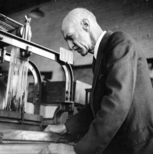 Dr. Thomas Nelson inspecting a textile machine