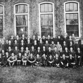 Class picture outside of Tompkins Hall with Dean Thomas Nelson seated in second row (seventh from right) and Dr. Hart in second row (sixth from right)