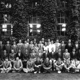 Group portrait of textile faculty and students in front of Tompkins Hall. Dean Thomas Nelson in second row, seventh from left