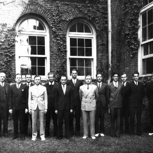 Group portrait of Textile students and faculty in front of Tompkins Hall