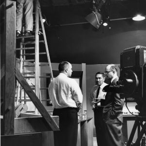 News broadcasting room with unknown men talking