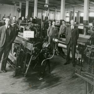 Textile class in Tompkins Hall textile machine room
