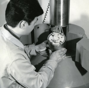 Demonstration of Gammacell 220 machine by research assistant in radiation lab
