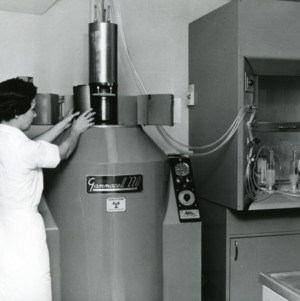 Research assistant demonstrating use of Gammacell 220