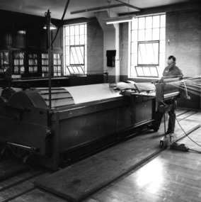 Fred Watkins, lab technician, with machinery in Tompkins Hall