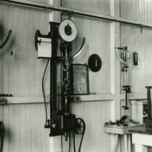 Old testing lab in Tompkins Hall prior to 1939 with scales and weighing equipment