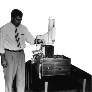 Bill Waters demonstrating small machine with spindle