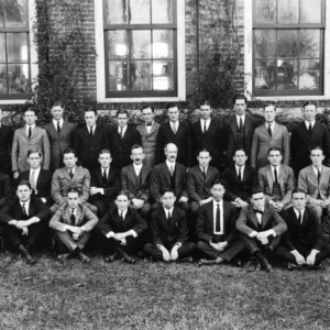 Textiles senior class of 1922 with faculty in front of Tompkins Hall. Dean Thomas Nelson in second row, fifth from right.