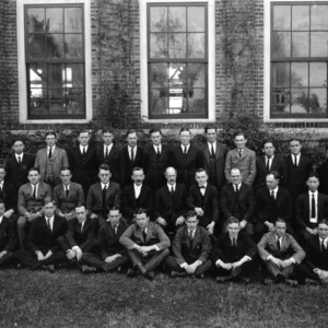 Textiles senior class of 1922 with faculty in front of Tompkins Hall