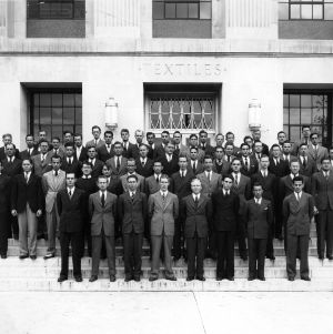 Textile graduating class in front of Nelson Hall