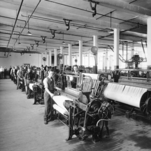 Dean Thomas Nelson and others with textiles machinery