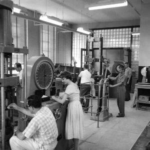 Students in a textile lab working with machinery