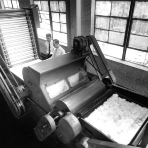 Students working with a cotton machine