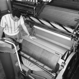 Student using a textile machine
