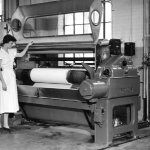 Woman demonstrating a Benninger Dye Jig Machine in Tompkins Hall