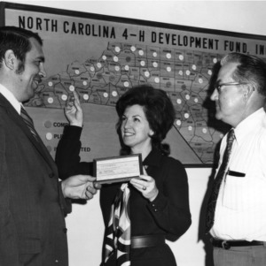 4-H Leader Dr. Chester D. Black accepts check for the NC 4-H Development Fund Campaign