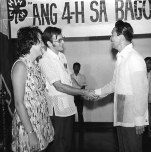 Carolyn J. Seymour and Lee Hood Capps meeting Ferdinand E. Marcos, President of the Republic of the Philippines