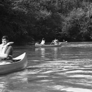 4-H club members canoeing on a river as a 4-H recreational activity, part of the 4-H personal development program