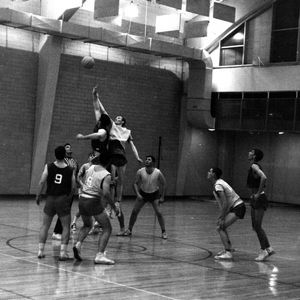 Students play in an intramural basketball game