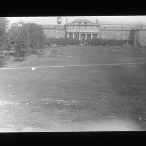 Meadow mushrooms in Court of the Carolinas lawn with 1911 building in background