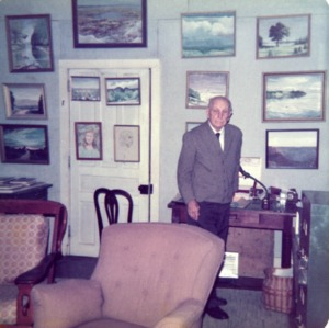 B. W. Wells in front of his paintings at NC State Student Union art show