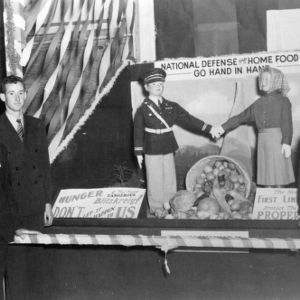 "Student agricultural fair exhibit at North Carolina State College, ""National defense and home food supply go hand in hand"""