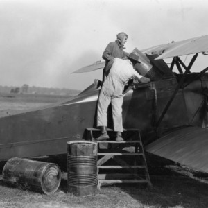 Loading airplane with calcium arsenate, November 28, 1925