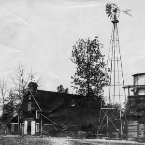 Barn, windmill, water tank, and pump house on Piedmont Branch Station, Statesville, N.C.