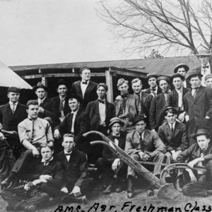 North Carolina College of Agriculture and Mechanic Arts freshman class posing with agricultural machinery, 1909