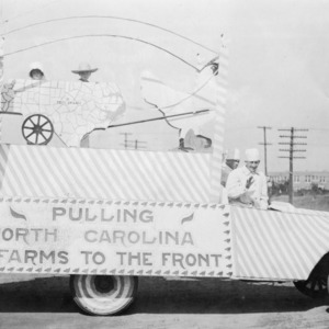 "Float at the Agricultural Fair reads, ""Pulling North Carolina farms to the front"""