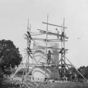 Photograph showing course of staves being put up during construction of a stave silo on the farm of M. W. Jackson, Edenton, North Carolina, September 28, 1926