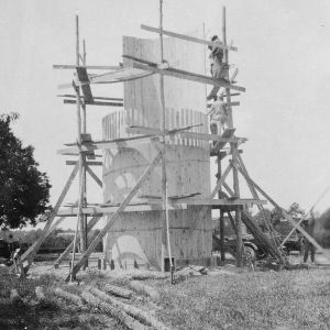 Photograph showing the first course of staves in place and second course being put in place, 1926